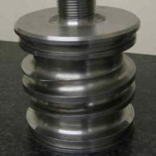 Spiral tracked tool steel water cooling core for plastics industry
